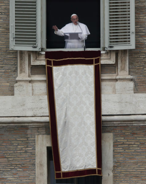 Pope Francis speaks to the crowd in St. Peter's Square before saying the Angelus prayer at the Vatican, Sunday, March 17, 2013. (AP Photo/Dmitry Lovetsky)