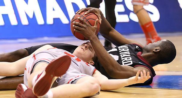 SALT LAKE CITY, UT - MARCH 21:  Cameron Bairstow #41 of the New Mexico Lobos and Steve Moundou-Missi #14 of the Harvard Crimson battle for a loose ball during the second round of the 2013 NCAA Men's Basketball Tournament at EnergySolutions Arena on March 21, 2013 in Salt Lake City, Utah.  (Photo by Streeter Lecka/Getty Images)