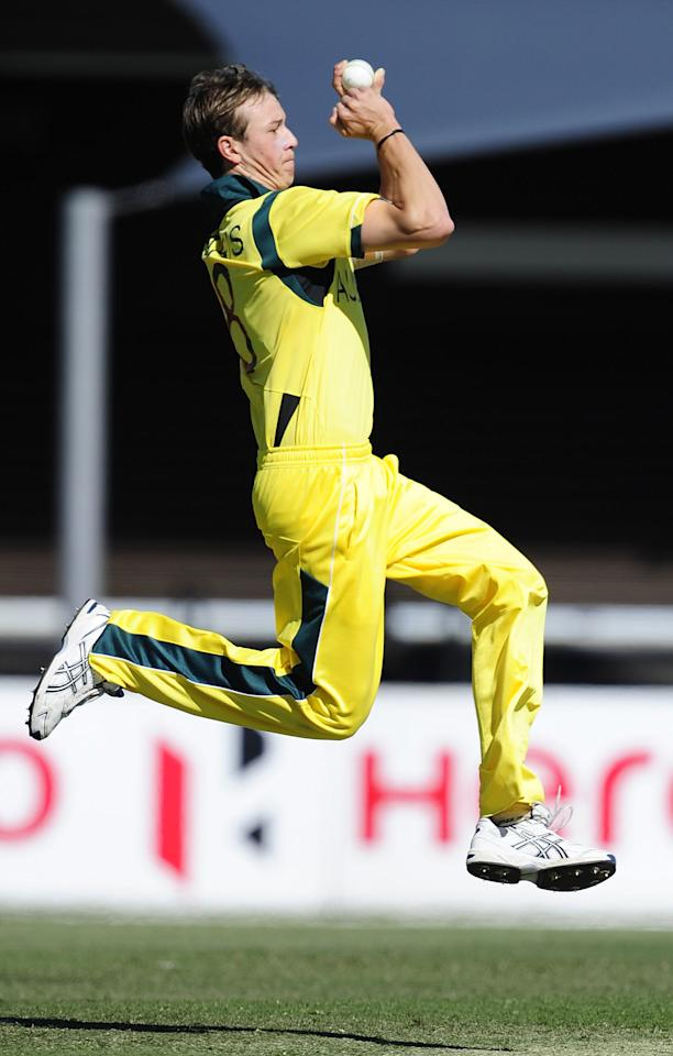 TOWNSVILLE, AUSTRALIA - AUGUST 11:  Joel Paris of Australia bowls during the ICC U19 Cricket World Cup 2012 match between Australia and England at Tony Ireland Stadium on August 11, 2012 in Townsville, Australia.  (Photo by Ian Hitchcock-ICC/Getty Images)