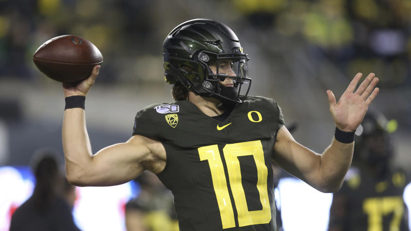 Oregon quarterback Justin Herbert warms up before an NCAA college football game Washington State Saturday, Oct. 26, 2019, in Eugene, Ore. (AP Photo/Chris Pietsch)