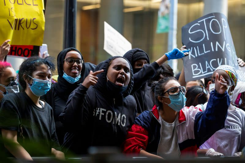 Protesters march to highlight deaths in Toronto.