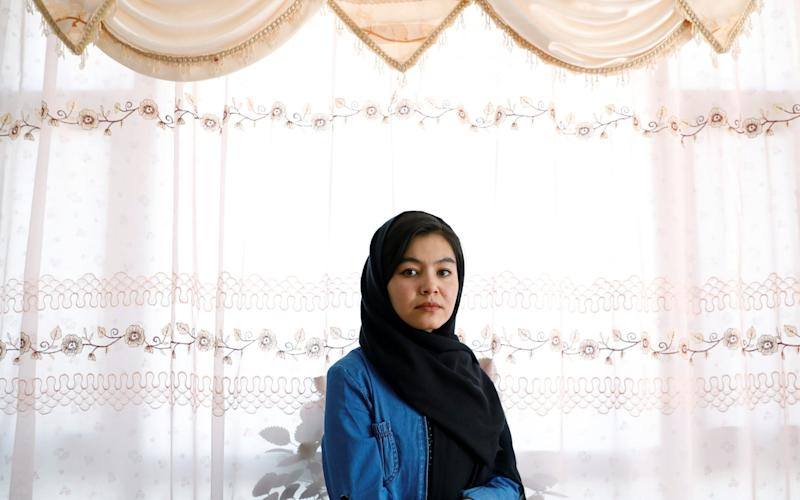 Shamsia Alizada,18, who came top in the country's university entrance exam, at her home in Kabul, Afghanistan - Reuters