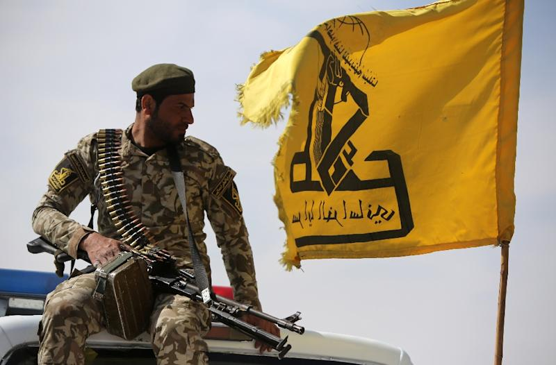 An Iraqi Shiite fighter and member of the Popular Mobilisation units supporting government forces in the battle against Islamic State, sits in a vehicle in the village of Albu Ajil, east of the city of Tikrit, on March 8, 2015 (AFP Photo/Ahmad Al-Rubaye)