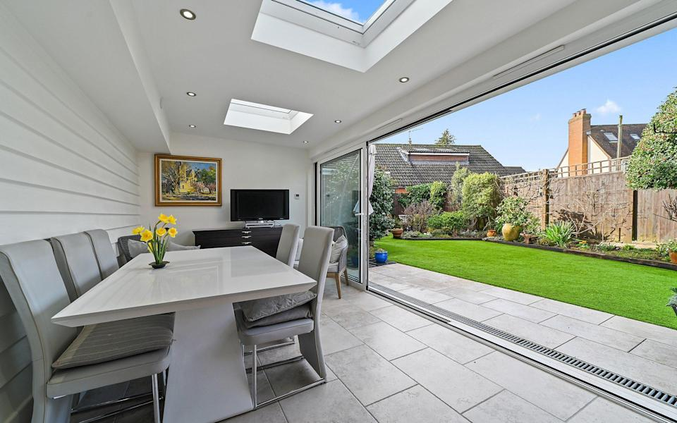 Barn Hall Cottage has an expansive kitchen with bi-fold doors into the garden - Savills Estate Agent