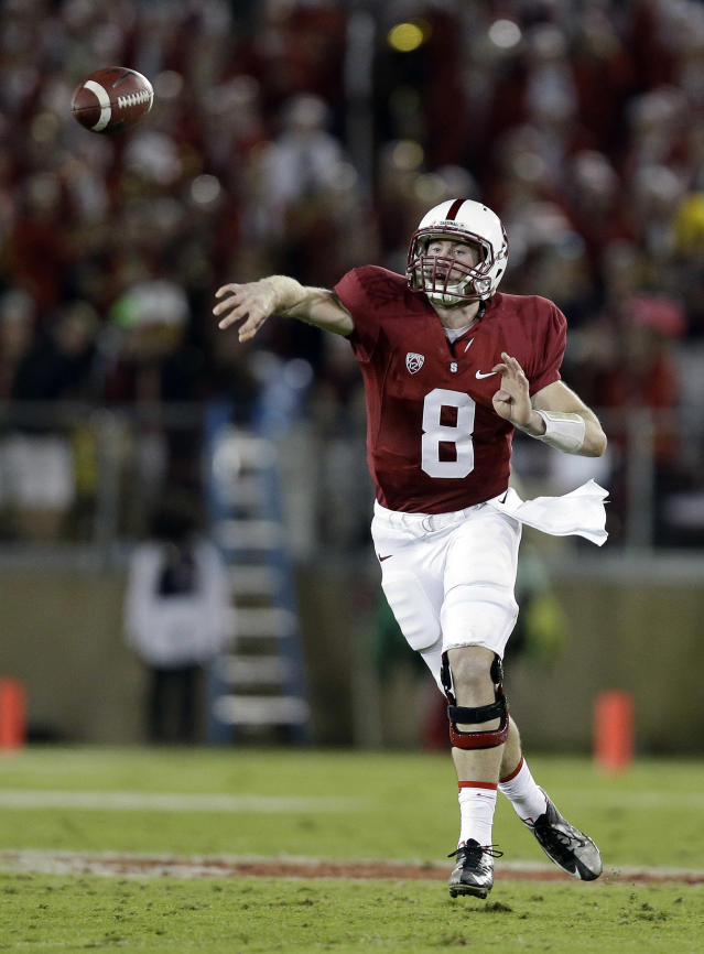 Stanford quarterback Kevin Hogan (8) throws against Notre Dame during the second half of an NCAA college football game on Saturday, Nov. 30, 2013, in Stanford, Calif. Stanford won 27-20. (AP Photo/Marcio Jose Sanchez)