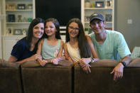 Cecilia Shaffette, second from right, poses for a family portrait with her father Rhett, sister Lydia and mother Angelle in their home in Carriere, Miss., Wednesday, June 16, 2021. Twelve-year-old Cecilia is thriving, eight months after getting a portion of her father's liver. She received the transplant after nearly losing her life to internal bleeding. (AP Photo/Gerald Herbert)
