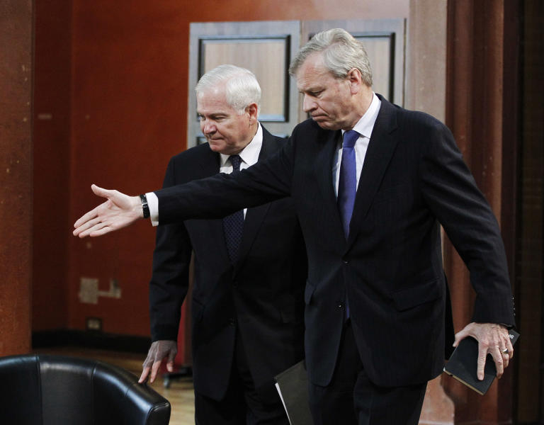 FILE - In this June 10, 2011, file photo then U.S. Defense Secretary Robert Gates, left, and former NATO Secretary General Jaap de Hoop Scheffer take part in the Security and Defense Agenda meeting in Brussels. During his final policy speech there as Pentagon Chief, Gates questioned the viability of NATO, saying its members' penny-pinching and lack of political will could hasten the end of U.S. support. (AP Photo/Jason Reed, Pool)