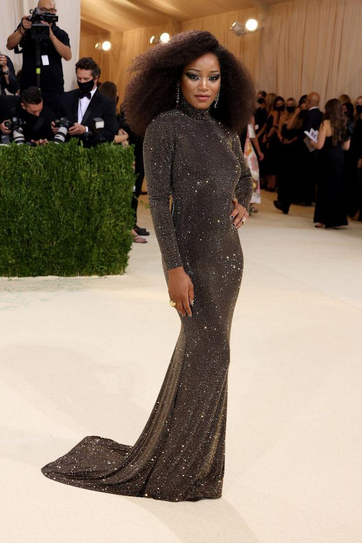 <p>Host Keke Palmer made a stunning entrance to the Met Gala carpet in a sparkling dark brown long-sleeve turtleneck Sergio Hudson gown. She accessorized with rings and earrings and wore her hair down.</p>