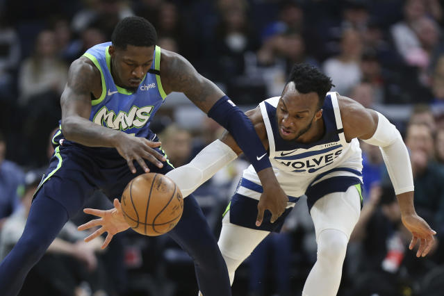 Minnesota Timberwolves' Josh Okogie, right, and Dallas Mavericks' Dorian Finney-Smith, left, go after the ball in the first half of an NBA basketball game Sunday, March 1, 2020, in Minneapolis. (AP Photo/Stacy Bengs)