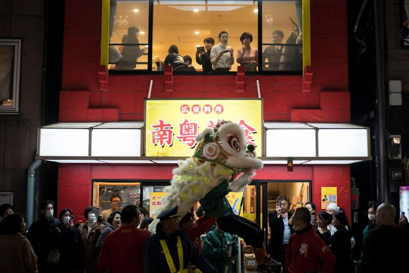 YOKOHAMA, JAPAN - JANUARY 25: A lion dance is performed outside a restaurant in Yokohama China Town on January 25, 2020 in Yokohama, Japan. Thousands of people gathered in the largest Chinese community in Japan to celebrate the Chinese Lunar New Year of the Rat. (Photo by Tomohiro Ohsumi/Getty Images)