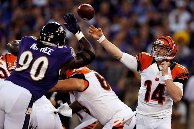BALTIMORE, MD - SEPTEMBER 10: Quarterback Andy Dalton #14 of the Cincinnati Bengals passes the ball in the first half against the defensive end Pernell McPhee #90 of the Baltimore Ravens at M&T Bank Stadium on September 10, 2012 in Baltimore, Maryland. (Photo by Rob Carr/Getty Images)