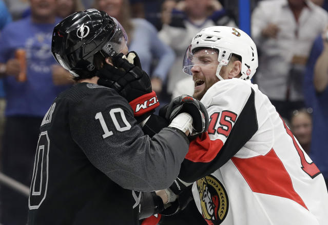 Ottawa Senators left wing Zack Smith (15) and Tampa Bay Lightning center J.T. Miller (10) battle during the second period of an NHL hockey game Saturday, March 2, 2019, in Tampa, Fla. Both players received roughing minor penalties. (AP Photo/Chris O'Meara)