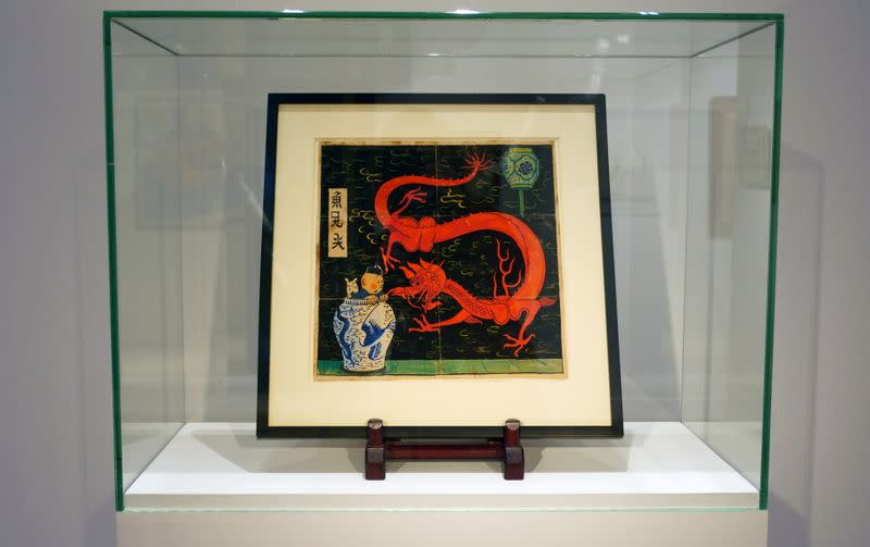 """Painting for the original cover of """"The Blue Lotus"""" Tintin comic book auctioned by Artcurial in Paris"""