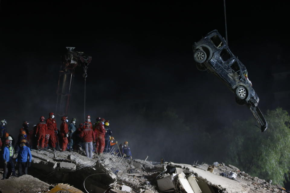 Members of rescue services work on the debris of a collapsed building in Izmir, Turkey, Sunday, Nov. 1, 2020. Rescue teams continue ploughing through concrete blocs and debris of collapsed buildings in Turkey's third largest city in search of survivors of a powerful earthquake that struck Turkey's Aegean coast and north of the Greek island of Samos, Friday Oct. 30, killing dozens Hundreds of others were injured.(AP Photo/Emrah Gurel)