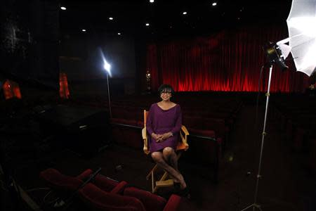 Academy President Cheryl Boone Isaacs poses for a portrait inside the The Samuel Goldwyn theatre at the Academy of Motion Picture Arts and Sciences in Beverly Hills, California February 19, 2014. REUTERS/Mario Anzuoni