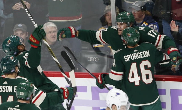 Minnesota Wild's Marcus Foligno, top right, is congratulated by teammates after his goal against St. Louis Blues goalie Jake Allen during the first period of an NHL hockey game Saturday, Nov. 2, 2019, in St. Paul, Minn. (AP Photo/Jim Mone)