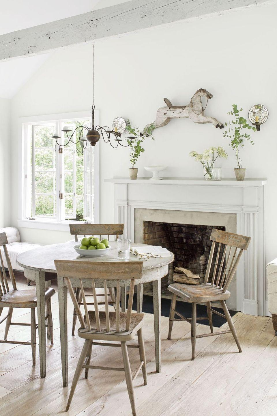 <p>Antiques with an old-world feel are always great for the fall season. Take a cue from this well-curated mantel, including a wall-mounted horse, and make a unique vintage find part of your decor. </p>