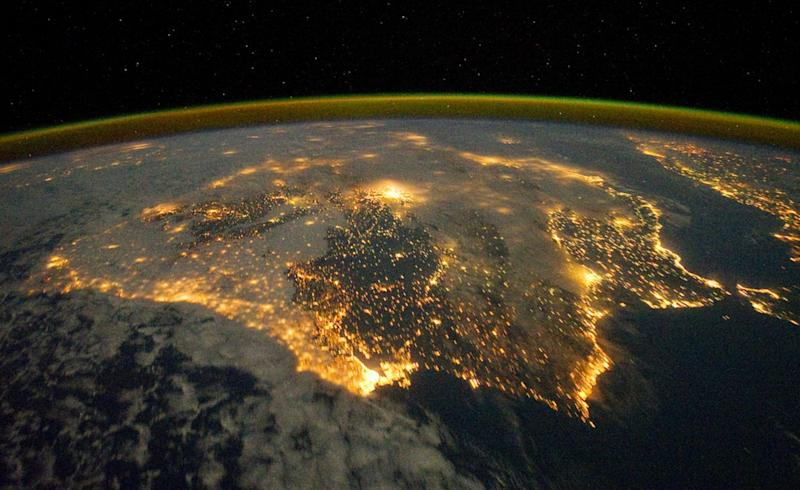 The city lights of Spain and Portugal define the Iberian Peninsula in this photograph from the International Space Station (ISS). Several large metropolitan areas are visible, marked by their relatively large and brightly lit areas, including the capital cities of Madrid, Spain—located near the center of the peninsula's interior—and Lisbon, Portugal—located along the southwestern coastline. The ancient city of Seville, visible to the north of the Strait of Gibraltar, is one of the largest cities in Spain. The astronaut view is looking toward the east, and is part of a time-lapse series of images.