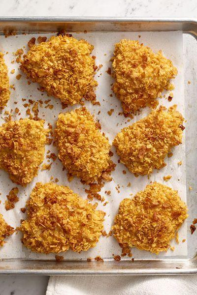 """<p>Made with spices and buttermilk, this light version tastes like traditional fried chicken with fewer calories and fat.</p><p><strong><a href=""""https://www.countryliving.com/food-drinks/recipes/a31925/crispy-baked-chicken-recipe-wdy0315/"""" rel=""""nofollow noopener"""" target=""""_blank"""" data-ylk=""""slk:Get the recipe"""" class=""""link rapid-noclick-resp"""">Get the recipe</a>.</strong></p>"""