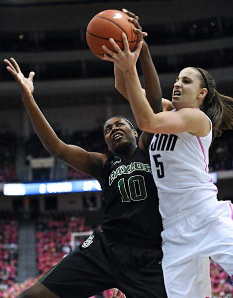 Baylor's Destiny Williams, left, and Connecticut's Caroline Doty, right, fight for control of the ball during the first half of an NCAA college basketball game in Hartford, Conn., Monday, Feb. 18, 2013. (AP Photo/Jessica Hill)