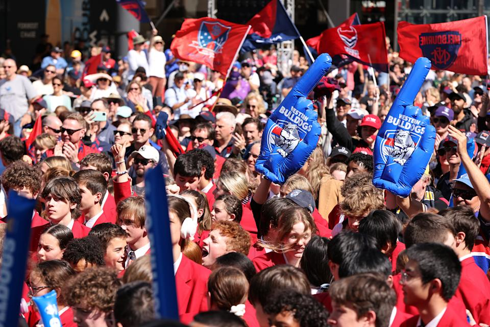 A big crowd gathers for the People's Parade ahead of the 2021 AFL Grand Final, at Optus Stadium on September 24, 2021 in Perth, Australia.