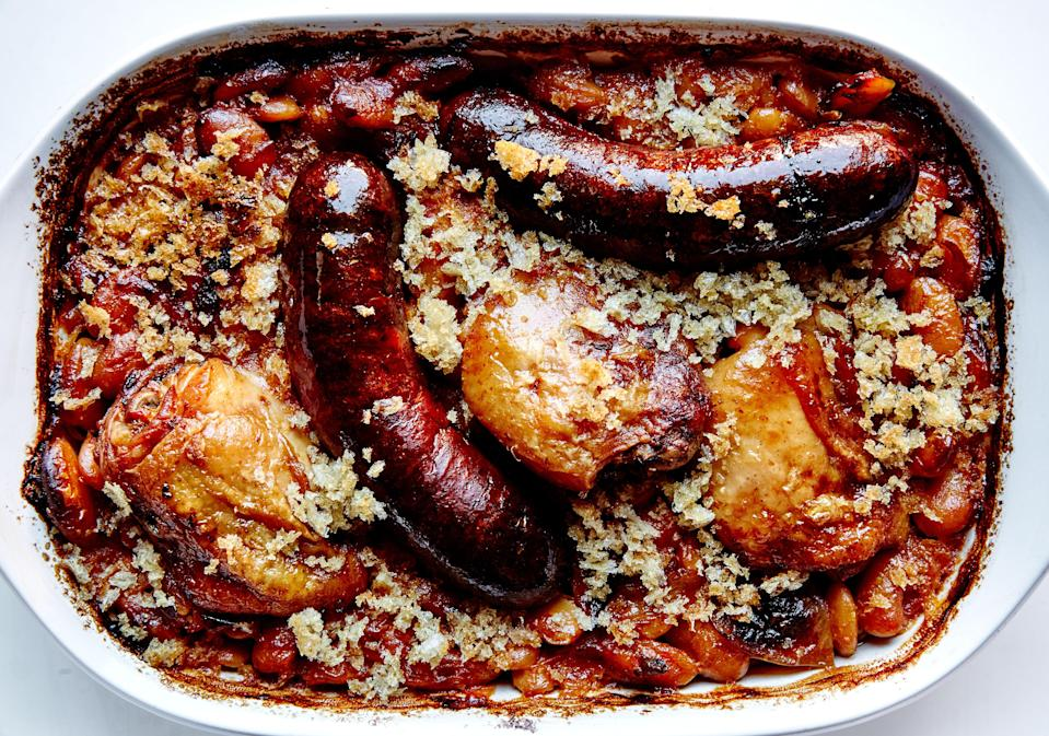 "This riff on a classic cassoulet skips most of the exotic ingredients and elaborate preparation but still delivers deep rich flavor. <a href=""https://www.bonappetit.com/recipe/confit-chicken-thigh-andouille-sausage-cassoulet?mbid=synd_yahoo_rss"" rel=""nofollow noopener"" target=""_blank"" data-ylk=""slk:See recipe."" class=""link rapid-noclick-resp"">See recipe.</a>"