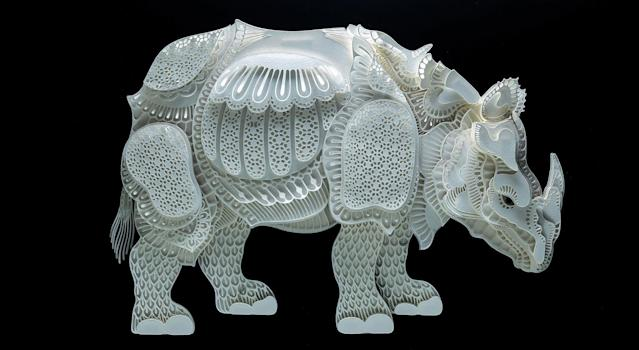 <p>Intricate paper cut out of a rhino. (Photo: Patrick Cabral/Caters News </p>