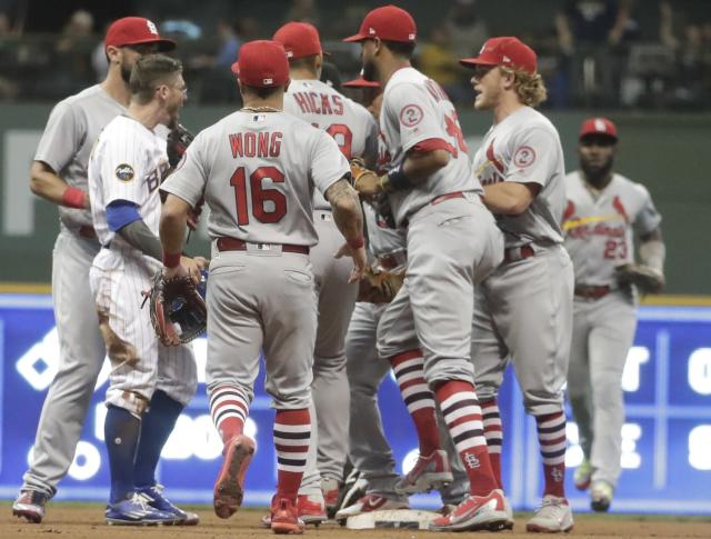Milwaukee Brewers' Eric Sogard argues with St. Louis Cardinals' Yairo Munoz during the eighth inning of a baseball game Friday, June 22, 2018, in Milwaukee. Both teams cleared their benches after the play. (AP Photo/Morry Gash)