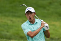 Collin Morikawa reacts to his chip shot to the fourth green during the final round of the Memorial golf tournament, Sunday, June 6, 2021, in Dublin, Ohio. (AP Photo/Darron Cummings)