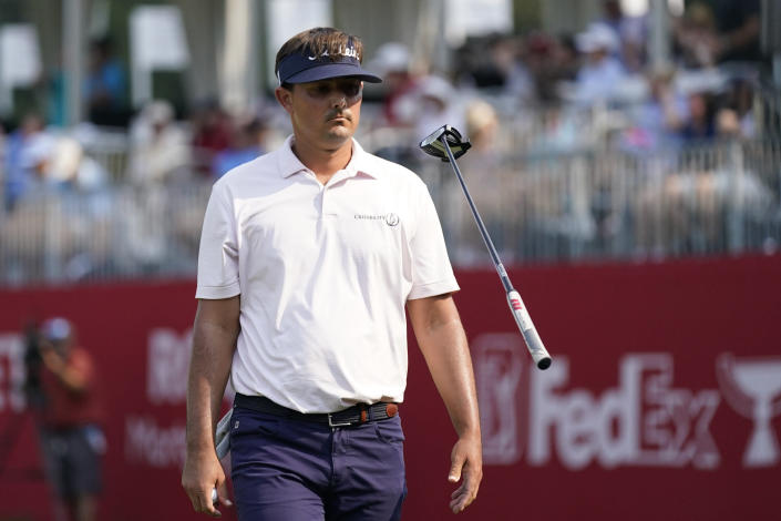 Hank Lebioda flips his putter on the 17th green during the final round of the Rocket Mortgage Classic golf tournament, Sunday, July 4, 2021, at the Detroit Golf Club in Detroit. (AP Photo/Carlos Osorio)