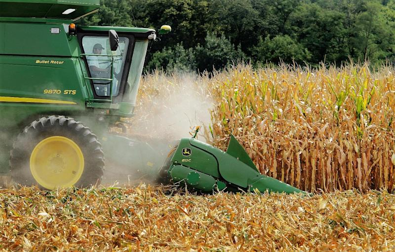 """FILE - This file photo taken Aug. 30, 2011,  in Central Illinois shows farmer Jason Podany using  a combine to harvest corn near Farmingdale, Ill. A bitter battle over whether high fructose corn syrup should simply be called """"corn sugar"""" is headed for a federal courtroom in Los Angeles. A U.S. District Court judge  on Tuesday, Sept. 13, 2011, is  set to weigh a motion to dismiss a lawsuit brought by the sugar industry which is upset  that manufactures of high fructose corn syrup want to rebrand the product. (AP Photo/Seth Perlman, File)"""