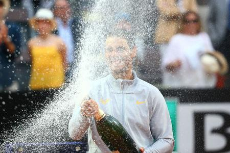 Tennis - ATP World Tour Masters 1000 - Italian Open - Foro Italico, Rome, Italy - May 20, 2018 Spain's Rafael Nadal celebrates with champagne after winning the final against Germany's Alexander Zverev REUTERS/Tony Gentile
