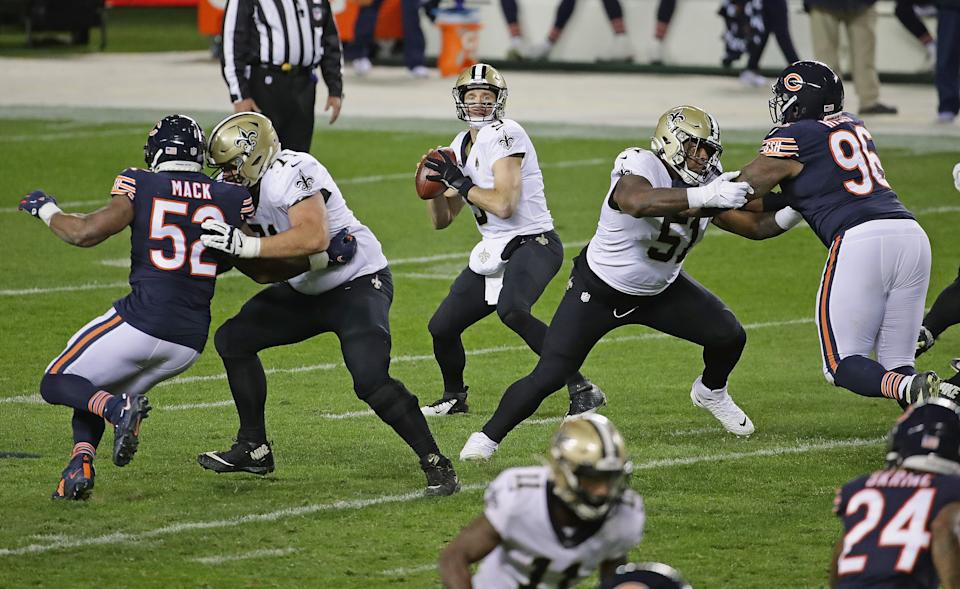 Drew Brees #9 of the New Orleans Saints looks for a receiver against the Chicago Bears at Soldier Field on November 01, 2020 in Chicago, Illinois. The Saints defeated the Bears 26-23 in overtime. (Photo by Jonathan Daniel/Getty Images)