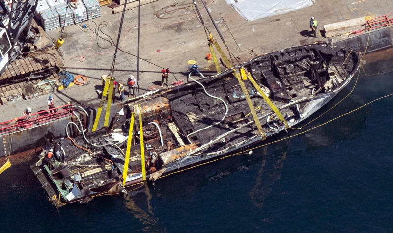 The burned hull of the Conception is brought to the surface by a salvage team, Thursday, Sept. 12, 2019, off Santa Cruz Island, Calif., in the Santa Barbara Channel in Southern California The vessel burned and sank on Sept. 2, taking the lives of 34 people aboard. Five survived. (Brian van der Brug/Los Angeles Times via AP)