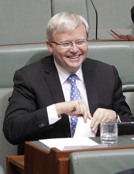 Former Australian Prime Minister Kevin Rudd smiles as he sits in parliament during question time in Canberra, Australia, Wednesday, June 26, 2013. Supporters of Prime Minister Julia Gillard's chief intra-party rival are again pushing for a vote to oust the Australian prime minister this week. (AP Photo/Rick Rycroft)