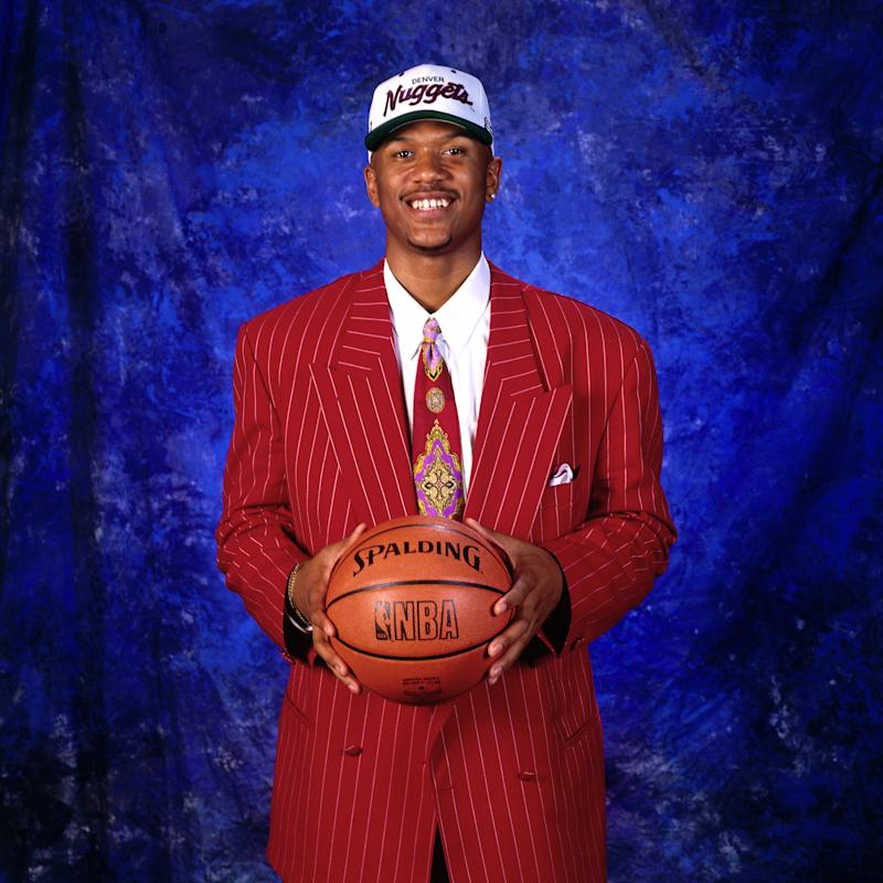 Jalen Rose wearing a big suit for a big man with big confidence.