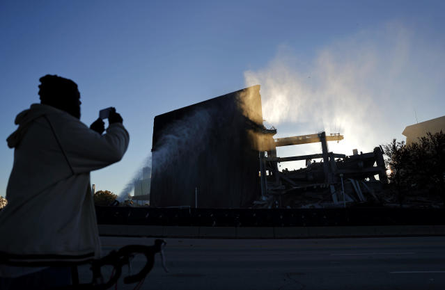 <p>Larry Jenkins takes a photo of the remains of the Georgia Dome after it was imploded in Atlanta, Monday, Nov. 20, 2017. The dome was not only the former home of the Atlanta Falcons but also the site of two Super Bowls, 1996 Olympics Games events and NCAA basketball tournaments among other major events. (AP Photo/David Goldman) </p>