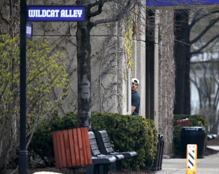 Northwestern football player Dan Vitale looks back at reporters and photographers as he walks into McGaw Hall, where voting is taking place on whether to form the nation's first union for college athletes, Friday, April 25, 2014, in Evanston, Ill. (AP Photo/Charles Rex Arbogast)