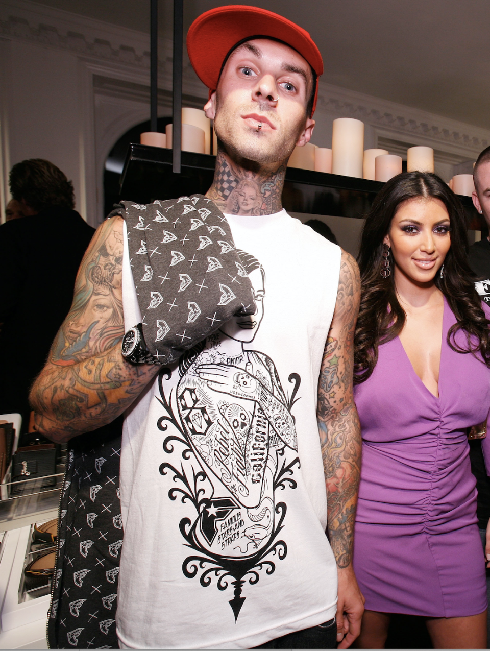 BEVERLY HILLS, CA - AUGUST 03: ***EXCLUSIVE*** Music recording artist Travis Barker (left), socialite Kim Kardashian (center left) and unidentified guests attend the LA Stars kick off event hosted by Baron Davis and Paul Pierce sponsored by FENDI at the Beverly Wilshire on August 3, 2007 in Beverly Hills, California. (Photo by Chris Weeks/WireImage)