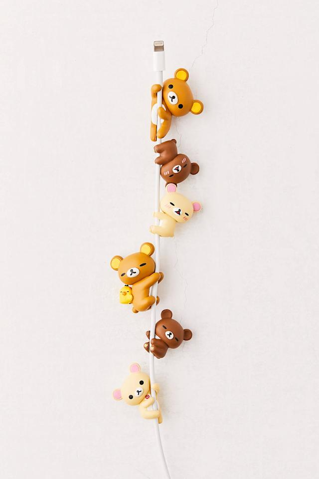 """<p>How cute is this <a href=""""https://www.popsugar.com/buy/Rilakkuma-Cable-Charm-496554?p_name=Rilakkuma%20Cable%20Charm&retailer=urbanoutfitters.com&pid=496554&price=9&evar1=geek%3Aus&evar9=36112587&evar98=https%3A%2F%2Fwww.popsugartech.com%2Fphoto-gallery%2F36112587%2Fimage%2F46701297%2FRilakkuma-Cable-Charm&list1=gifts%2Choliday%2Cstocking%20stuffers%2Cgift%20guide%2Cdigital%20life%2Cgifts%20under%20%2425%2Cunder%20%24100%2Cgifts%20for%20women%2Cgifts%20for%20men&prop13=mobile&pdata=1"""" rel=""""nofollow"""" data-shoppable-link=""""1"""" target=""""_blank"""" class=""""ga-track"""" data-ga-category=""""Related"""" data-ga-label=""""https://www.urbanoutfitters.com/shop/rilakkuma-cable-charm?category=cell-phone-accessories&amp;color=000&amp;type=REGULAR"""" data-ga-action=""""In-Line Links"""">Rilakkuma Cable Charm</a> ($9)?</p>"""