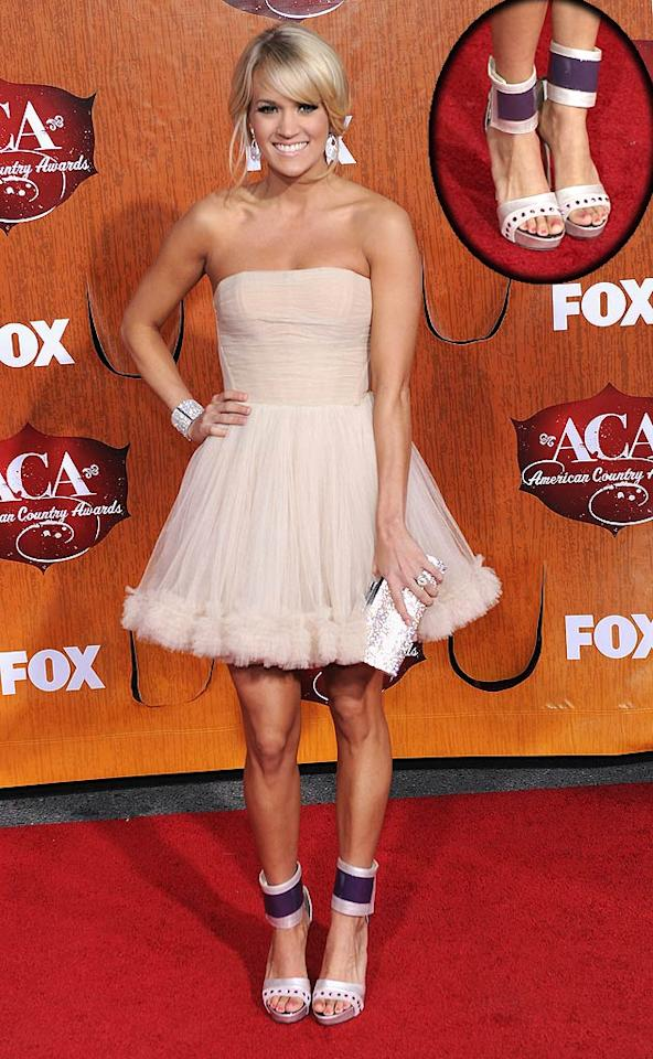 Carrie Underwood looked cute as can be in her strapless Maria Lucia Hohan dress at the 2011 American Country Awards. Too bad her shoes -- atrocious ankle-straps, courtesy of Ryan Haber -- ruined what could have been a flawless ensemble.  (12/5/2011)