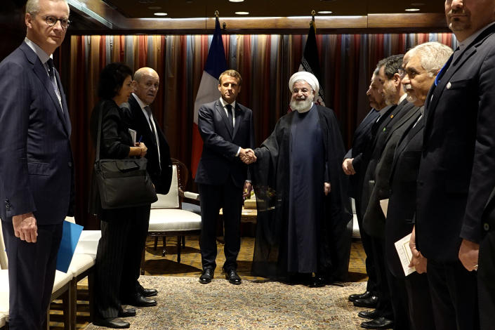 President Hassan Rouhani, right, shakes hands with French President Emmanuel Macron during their meeting on the sideline of the United Nations General Assembly at U.N. headquarters on Sept. 24, 2019. (Photo: Iranian Presidency Office via AP)