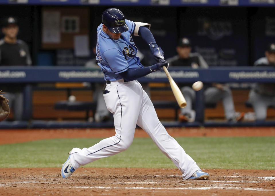 Tampa Bay Rays' Daniel Robertson hits a pinch-hit walkoff grand slam in the ninth inning of a baseball game to defeat the Miami Marlins, Sunday, July 22, 2018, in St. Petersburg, Fla. (AP Photo/Mike Carlson)