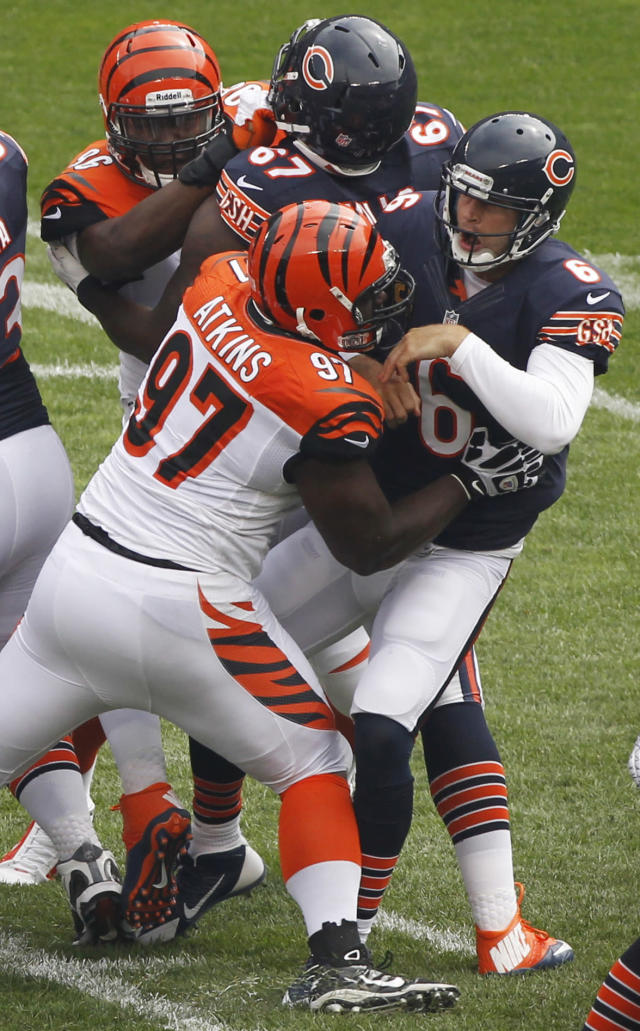 Chicago Bears quarterback Jay Cutler (6) is pressured by Cincinnati Bengals defensive tackle Geno Atkins (97) after throwing a pass during the first half of an NFL football game, Sunday, Sept. 8, 2013, in Chicago. (AP Photo/Kiichiro Sato)