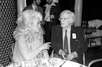 <p>Dolly Parton and Andy Warhol crossed paths several times throughout her career, and she most notably inspired his 1985 portrait of the singer. Here, at a Windows on the World event in New York City, she likely had the biggest hair in all of Manhattan. </p>