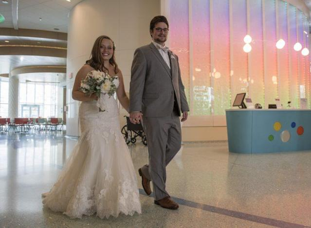 Foster Rozema and her new husband in the hospital. (Photo: Chris Clark, Spectrum Health Beat)