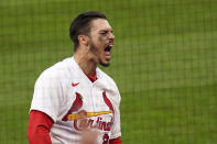 St. Louis Cardinals' Nolan Arenado celebrates after hitting a two-run home run during the eighth inning of a baseball game against the Milwaukee Brewers Thursday, April 8, 2021, in St. Louis. (AP Photo/Jeff Roberson)