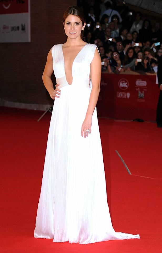 """""""Twilight"""" star Nikki Reed wowed the crowd at the Rome Film Festival when she donned a plunging Maria Lucia Hohan pleated gown. Her new hubby, former """"American Idol"""" contestant Paul McDonald, is one lucky guy! (10/30/2011)"""