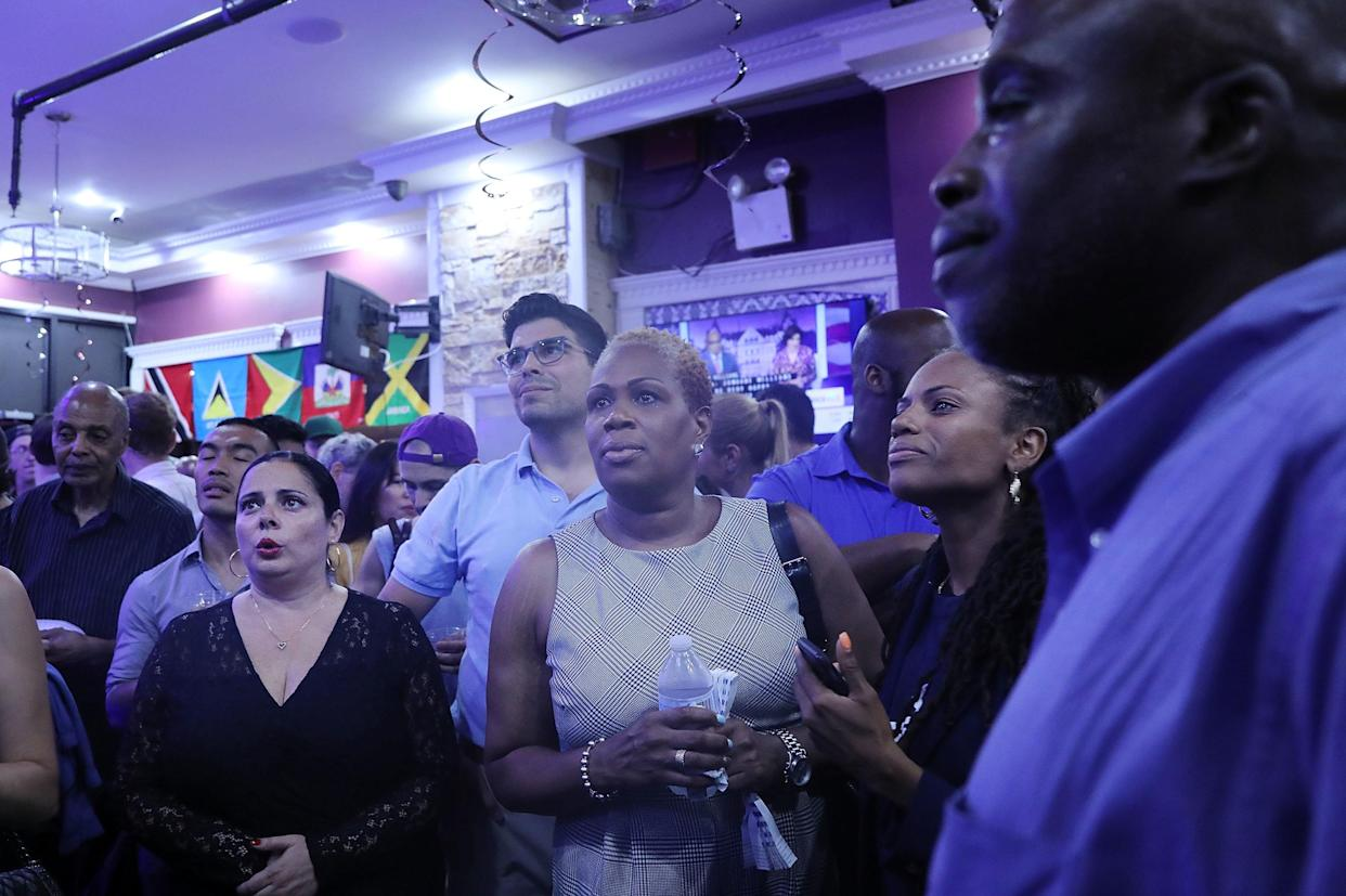 Supporters watched the results of the New York Democratic primary race at candidate Cynthia Nixon's election night watch party. (Spencer Platt via Getty Images)