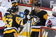 Pittsburgh Penguins' Colton Sceviour (7) celebrates his goal with Teddy Blueger (53) during the first period of the team's NHL hockey game against the Washington Capitals in Pittsburgh, Tuesday, Jan. 19, 2021. (AP Photo/Gene J. Puskar)